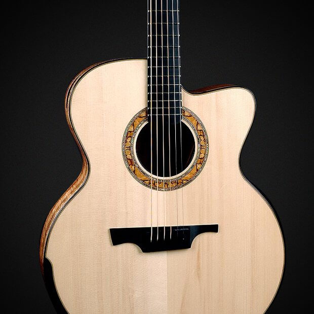 Model G4 - Adirondack red Spruce soundboard, Hawaiian Koa Back and Sides, Ebony String-Through Bridge, Black Horn Saddle, Proprietary Greenfield Spalted Beech and Paua Rosette